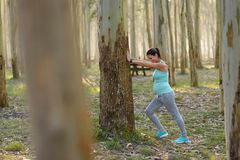 Pregnant healthy woman on fitness outdoor workout stretching cal Royalty Free Stock Image