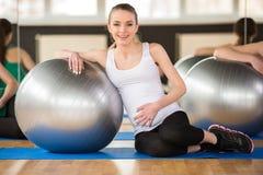 Pregnant woman. Fitness. Stock Photos