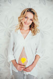 A pregnant woman with flower. Happy family. a pregnant woman. yeloww flower stock images