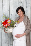 Pregnant woman with flowers Royalty Free Stock Photo