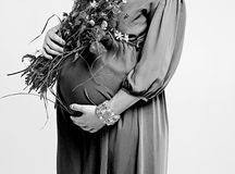 Pregnant woman and flowers Stock Photo