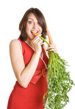 Pregnant woman with fresh carrots Royalty Free Stock Image