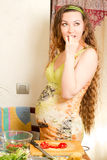 Pregnant  woman with fresh fruit on kitchen Stock Images