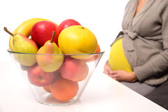 Pregnant woman and fresh fruits Royalty Free Stock Photo