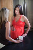 Pregnant Woman with Friend Stock Images