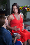 Pregnant Woman With Friend Royalty Free Stock Photography