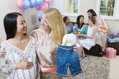 Pregnant Woman And Friend At A Baby Shower Stock Photography