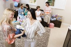 Pregnant Woman And Friend At A Baby Shower Royalty Free Stock Photo