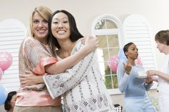 Pregnant Woman And Friend Hugging Stock Photo