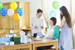 Pregnant woman with friends at a baby shower Royalty Free Stock Photography