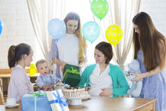 Pregnant woman with friends at a baby shower Stock Images