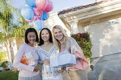 Pregnant Woman With Friends Holding Gifts Royalty Free Stock Images