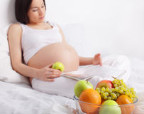 Pregnant woman with fruit Royalty Free Stock Image