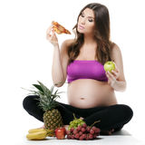 Pregnant woman,fruit and pizza,healthy eating Royalty Free Stock Photography