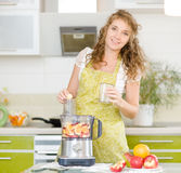Pregnant woman with fruit Stock Photo