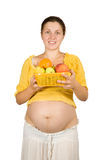 Pregnant woman with  fruits Stock Photography