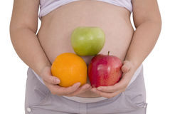 Pregnant woman with fruits Clipping path Stock Photos