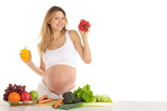 Pregnant woman with fruits and vegetables Stock Photos