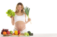 Pregnant woman with fruits and vegetables Royalty Free Stock Photo