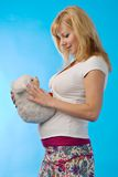 Pregnant woman with fur toy Royalty Free Stock Photography