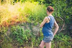 Pregnant woman in garden Stock Image