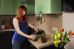 Pregnant woman getting pickled cucumber Stock Photos