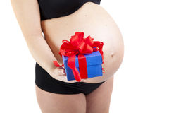 Pregnant woman with gift box. Isolated stock photography