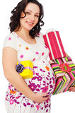 Pregnant woman with gift boxes Stock Photos