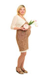 Pregnant woman with gift and flowers Royalty Free Stock Photography