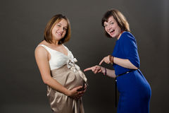 Pregnant woman and girfriend Stock Images