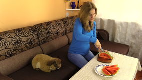 Pregnant woman girl cut fresh watermelon. Preparing healthy food stock video