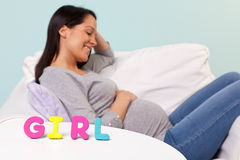 Pregnant woman GIRL in front royalty free stock photo