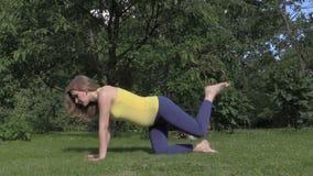 Pregnant woman girl sport exercise during pregnancy. Leg rising stock video