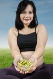 Pregnant woman gives kiwi fruit Royalty Free Stock Photos