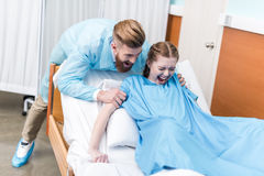 Pregnant woman giving birth in hospital Stock Images