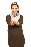 Pregnant woman giving piggy bank Royalty Free Stock Image