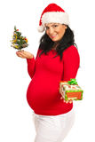 Pregnant woman giving Xmas gift Royalty Free Stock Photo