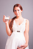 Pregnant woman with glass of milk Royalty Free Stock Photo