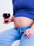 Pregnant woman with a glass of wine Royalty Free Stock Photo
