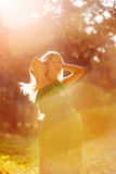 Pregnant woman in the glow of evening light royalty free stock images