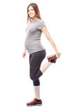 Pregnant woman going for a run Stock Photo