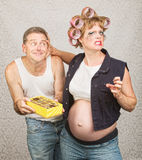 Pregnant Woman Grabbing Man. Frustrated pregnant women grabbing apologetic man's face Royalty Free Stock Images