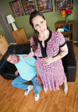 Pregnant Woman Grabbing Man's Collar Royalty Free Stock Photos