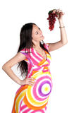 Pregnant woman with grape Royalty Free Stock Photo