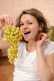 Pregnant woman with grapes Royalty Free Stock Photo