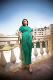 Pregnant woman in green dress Stock Images
