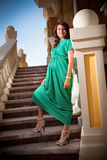 Pregnant woman in green dress Royalty Free Stock Photography