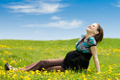 Pregnant woman on green grass stock images