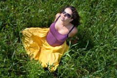 Pregnant woman on green grass field under blue sky Royalty Free Stock Images