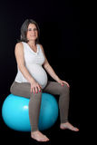 Pregnant woman and gym ball Stock Photos